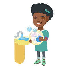 little african girl washing dishes in the sink vector image vector image