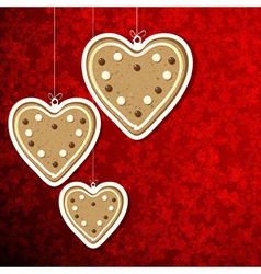 Christmas background with gingerbread hearts vector