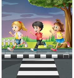 Three kids running along the road vector image