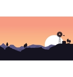 Silhouette of windmill and house landscape vector image vector image