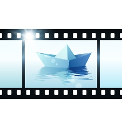 Photo film with origami boat vector