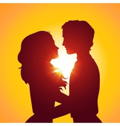Sunset silhouettes of kissing couple vector