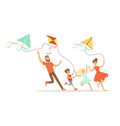 Happy family with two kids having fun flying kites vector