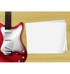 A red guitar with an empty piece of paper vector