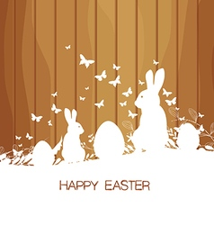Easter greeting card with rabbit on the wooden vector