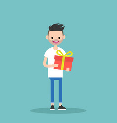 Young happy bearded man holding a bright gift box vector