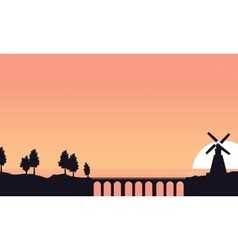 Bridge and windmill scenery of silhouettes vector image vector image