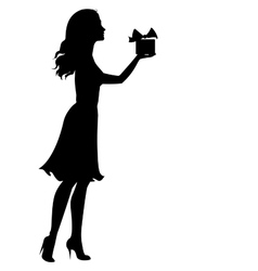 Silhouette of woman holding a gift box vector