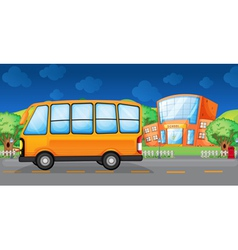 A yellow bus along the street vector image vector image