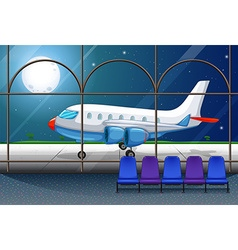 Airport scene with airplane parking at night vector