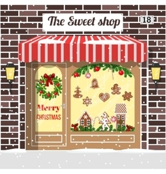 Christmas decorated and illuminated sweet shop vector