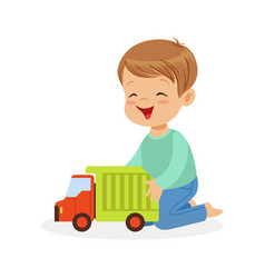 cute happy little boy sitting on the floor playing vector image vector image