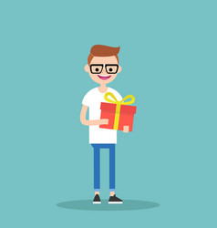 Young happy nerd holding a bright gift box vector