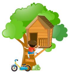 Boy climbing up the treehouse vector