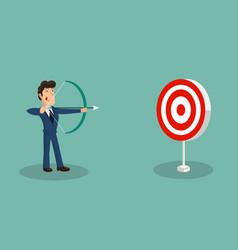 Successful businessman shooting arrow at target vector