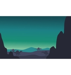 Spinosaurus silhouette in hills vector