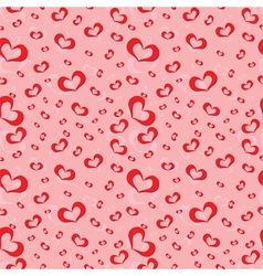 Seamless pattern of symbolic hearts vector