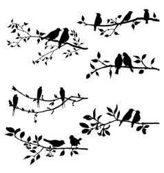 Set of birds at tree branches silhouettes vector