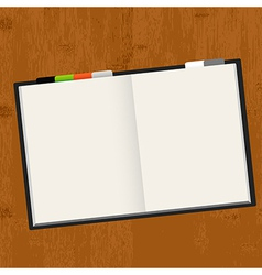 Wooden table with notebook vector