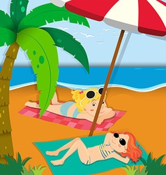 Two girls sunbathing on the beach vector