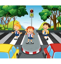 Three students at the zebra crossing vector