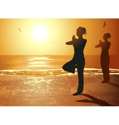 Silhouettes of girls doing yoga on the beach vector
