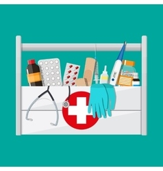First aid kit with pills and medical devices vector image vector image