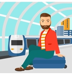 Man sitting on railway platform vector