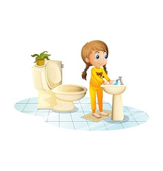 A young lady washing her hands vector image
