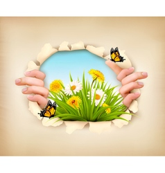 Spring background with hands ripping paper to show vector image