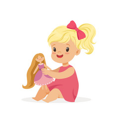 Sweet little girl in a pink dress playing with her vector