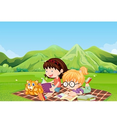 Girls reading at the field vector image