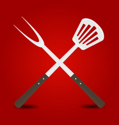 Crossed big fork and spatula on red background vector