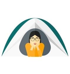 Woman lying in tent vector