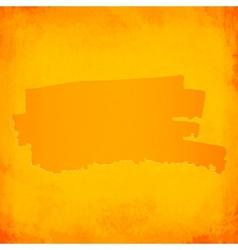 Orange brush spot on grunge background vector