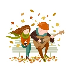 Boy plays guitar for a girl in the autumn park vector