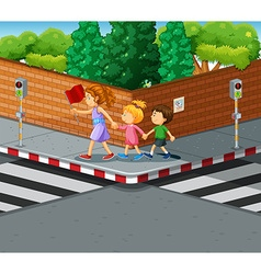 Woman helping kids crossing the street vector