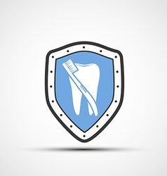 shield with a human tooth and toothbrush vector image vector image