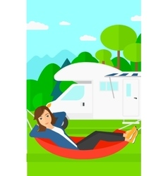 Woman lying in hammock vector