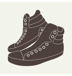 brown sneakers on beige background vector image