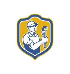 Plumber holding wrench side shield retro vector