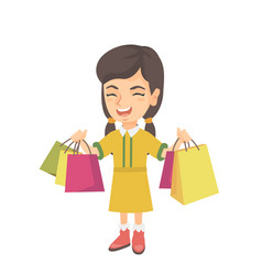 Happy caucasian girl holding shopping bags vector