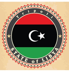 Vintage label cards of libya flag vector