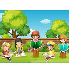 Children reading books in the garden vector