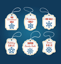 christmas sale tags on blue background vector image vector image