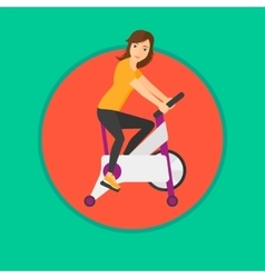 Woman riding stationary bicycle vector