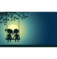 Moonlight silhouettes of a boy and girl vector image