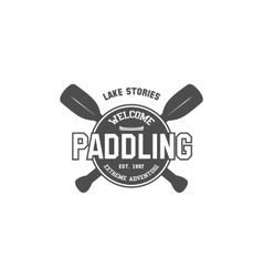 Vintage paddling kayaking canoeing camp logo vector