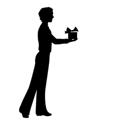 Silhouette of man holding a gift box vector image