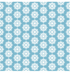 Seamless pattern with snowflakes on blue vector